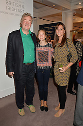 Left to right, CHRISTOPHER SIMON SYKES, JULIE CLAPTON and her mother MELIA CLAPTON at a reception to celebrate the publication of Hockney - A Pilgrim's Progress by Christopher Simon Sykes held at Sotheby's, New Bond Street, London on 30th September 2014.