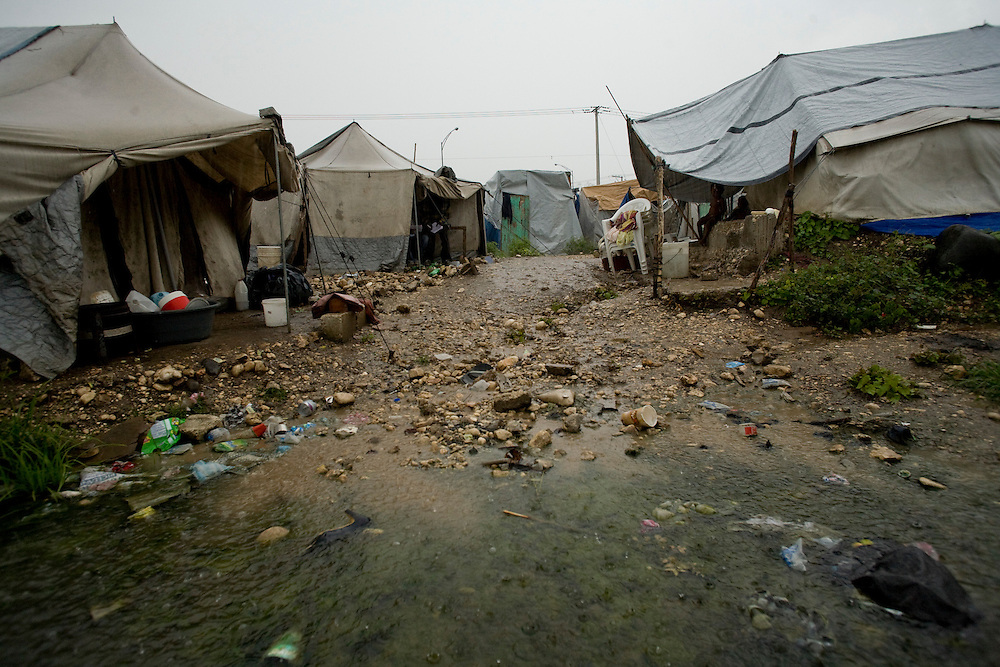 A flooding camp of people displaced by the earthquake.