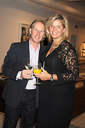 JOHN & BELLE ROBINSON at a party to celebrate the 2nd issue of Distill Magazine held at The Shop at Bluebrid, Kings Road, London on 1st December 2008.