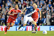 Birmingham City midfielder David Cotterill gets away from Middlesbrough midfielder Emilio Nsue during the Sky Bet Championship match between Birmingham City and Middlesbrough at St Andrews, Birmingham, England on 29 April 2016. Photo by Alan Franklin.