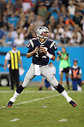 New England Patriots quarterback Tom Brady (12) throws into the end zone on his first drive of the night during the 2016 NFL preseason football game against the Carolina Panthers on Friday, Aug. 26, 2016 in Charlotte, N.C. The Patriots won the game 19-17. (©Paul Anthony Spinelli)