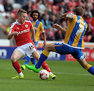 Marley Watkins of Barnsley is tackled by Lliam Lawrence of Shrewsbury Town during the Sky Bet League 1 match at Oakwell, Barnsley<br /> Picture by Graham Crowther/Focus Images Ltd +44 7763 140036<br /> 05/09/2015