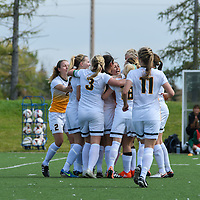 3rd year forward Brianna Wright (7) of the Regina Cougars  celebrates with the team after scoring the equalizing goal during the 31st minute of the Women's Soccer Homeopener on September 10 at U of R Field. Credit: Arthur Ward/Arthur Images