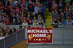 LIVERPOOL, ENGLAND - Wednesday, September 16, 2009: Liverpool's supporters display a banner welcoming fellow fan Michael Shields home, after serving over four years in jail for a crime he did not commit, during the UEFA Champions League Group E match against Debreceni at Anfield. (Photo by David Rawcliffe/Propaganda)