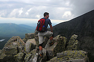 Jared Leonard rests during the climb to the top of Maine's Mt Katahdin in Baxter State Park.  Jared was climbing as part of a 60th birthday celebration for John Walcott (not pictured).  Walcott has been climbing the mountain, the highest in Maine and the northern terminus of the Appalachian Trail since 1976.