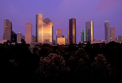Stock photo of an evening view of the downtown Houston skyline seen from the western side