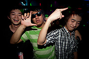 THREE ASIAN YOUTHS SMILING AND GESTUTING GREEN STRIPY T SHIRT