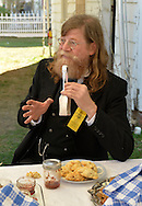Old Bethpage, New York, U.S. 29th September 2013. NORMAN ERIKSON, of Greenlawn, is holding antique silver tongs and wearing a reproduction of a yellow Reunion Ribbon for the Grand Army of the Republic, Moses Baldwin Post 544, at The Long Island Fair. A yearly event since 1842, the county fair is now held at a reconstructed fairground at Old Bethpage Village Restoration.