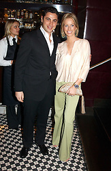 CEM & CAROLINE HABIB at a fund raising dinner hosted by Marco Pierre White and Frankie Dettori's in aid of Conservative Party's General Election Campaign Fund held at Frankie's No.3 Yeoman's Row,æLondon SW3 on 17th January 2005.<br />