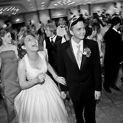 "Newlywed, Jessica Dalton (left, age 17), laughs as her husband Casey Dalton (right, age 17), misses a step during a line dance for the song ""Cha Cha Slide"" by Casper during William Fleming's ""A Night in Paris"" prom held at the Wyndam Hotel in Roanoke, Virginia. ""The hard part is over. Now I just have to meet a bunch of people."", Casey said on the way down. ""A lot of people (William Fleming students) know that someone (from the school) got married, but not many know who I am"", said Jessica."
