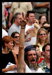 21 June, 2006. New Orleans, Louisiana. Wednesday at the Square. Faces in the crowd at the free music performance by 'The Chee Weez' cover band at Lafayette Square, a regular free weekly concert featuring various performers at the heart of the Central Business District. The concerts bring much cheer to New Orleanians and help bring cheer to a depressed city.