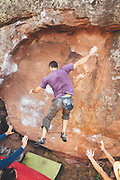 Climbers practicing boulder in Rodeno forest in Albarracin, Spain