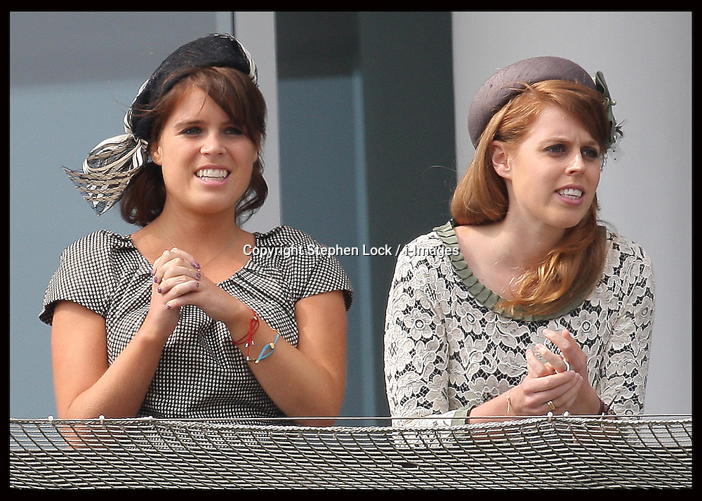 Princess's Eugenie and Beatrice cheer on the winner of   the Epsom Derby, Saturday, 2nd June 2012.  Photo by: Stephen Lock / i-Images