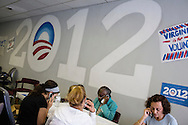 Natalie Schwartz, Rosa Segovia, Alice W. Harris, and Anahita Knonsari, from left, volunteers with Organizing for America, President Obama's re-election campaign arm, make phone calls to potential supporters in the group's Richmond headquarters on Thursday, May 3, 2012 in Richmond, VA.