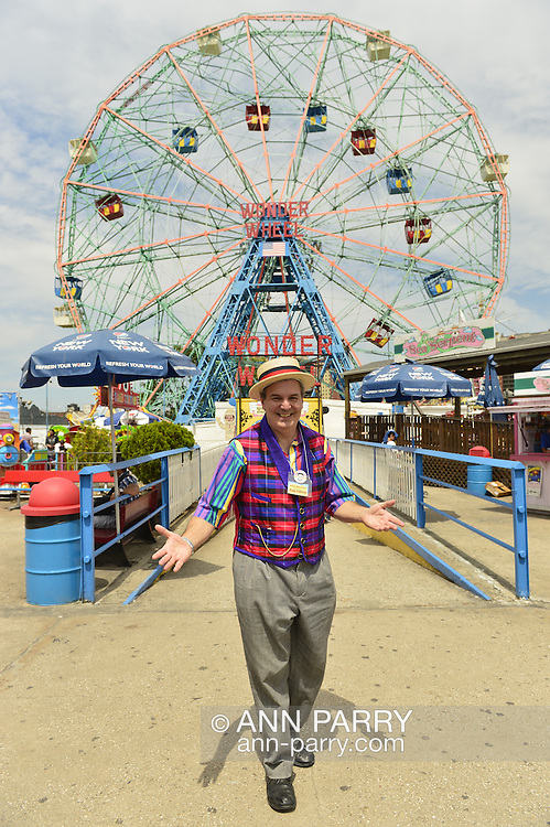 Brooklyn, New York, USA. 10th August 2013. BOB YORBURG, AKA Professor Phineas FeelGood the Magician, of Yorktown Heights, strikes a pose in front of the Wonder Wheel at Luna Park, during the 3rd Annual Coney Island History Day celebration. Yorburg restored Coney Island's famous Grandmothers Predictions fortune telling game after Grandma was seriously damaged during Hurricane Sandy, in October 2012.