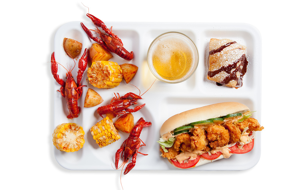 Shrimp Po' Boy, crawfish boil with corn and new potatoes, beignet with chocolate and powdered sugar, beer. Photograph by Jonathan Gayman, food styling by Carrie Province.