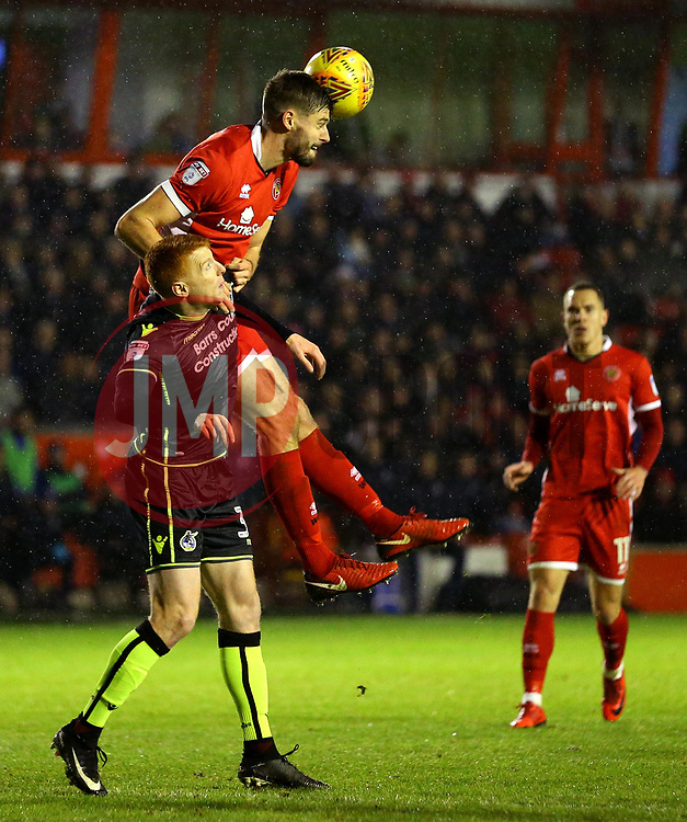 Rory Gaffney of Bristol Rovers is beaten in the air Jon Guthrie of Walsall - Mandatory by-line: Robbie Stephenson/JMP - 26/12/2017 - FOOTBALL - Banks's Stadium - Walsall, England - Walsall v Bristol Rovers - Sky Bet League One