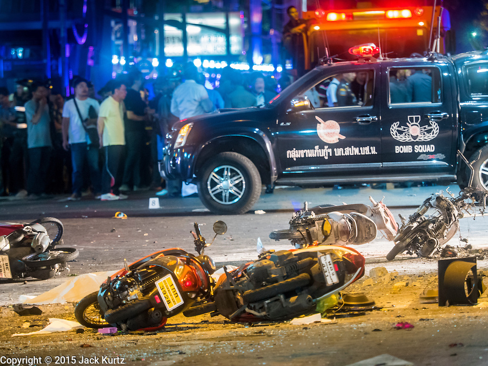 17 AUGUST 2015 - BANGKOK, THAILAND: Destroyed motorcycles in the road in front of Erawan Shrine. An explosion at Erawan Shrine, a popular tourist attraction and important religious shrine, in the heart of the Bangkok shopping district killed at least 19 people and injured more than 120 others, mostly foreign tourists, during the Monday evening rush hour. Twelve of the dead were killed at the scene. Thai police said an Improvised Explosive Device (IED) was detonated at 18.55. Police said the bomb was made of more than six pounds of TNT stuffed in a pipe and wrapped with white cloth. Its destructive radius was estimated at 100 meters. The Bangkok government announced that public schools would be closed Tuesday as a precaution.         PHOTO BY JACK KURTZ