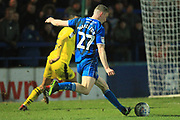 Ethan Hamilton shoots during the EFL Sky Bet League 1 match between Rochdale and Oxford United at Spotland, Rochdale, England on 12 March 2019.