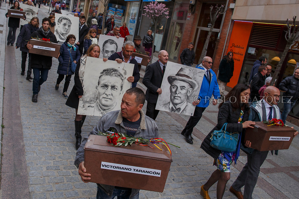 14/04/2018. Relatives and supporters carry coffins containing the bodies of victims of Spain Civil War and portraits depicting them along the streets of Soria city during a homage to hand the remains to their families on April 14, 2018 in Soria, Spain. La Asociacion Soriana Recuerdo y Dignidad (ASRD) 'The Soria Association for Memory and Dignity' celebrated a tribute to hand over the remains of civil war victims to their families. The Society of Sciences of ARANZADI helped with the research, exhumation and identification of the bodies, after villagers passed the information about the mass grave, 81 years after the assassination took place, to the ASRD. Seven people were assassinated around August 25, 1936 by Falangists, as part of General Francisco Franco armed forces, and buried in the 'Fosa de los Maestros' (Teachers Mass Grave) near Cobertelada, Soria, after being taken from prison of Almazan during the Spanish Civil War. Five of them were teachers in the region, and also friends of Spanish writer Antonio Machado. The other two still remain unidentified. Another body was assassinated by Falangists accompanied by a priest in 1936, and was exhumed on 23 September of 2017 near Calata&ntilde;azor, Soria. It belonged to Abundio Andaluz, a politician, lawyer and musician in Soria.<br /> Spain's Civil War took the lives of thousands of people on both sides, and civilians. But Franco continued his executions after the war has finished. Teachers, as part of the education sector, were often a target of Franco's forces. Spanish governments has never done anything to help the victims of the Civil War and Franco's dictatorship while there are still thousands of people missing in mass graves around the country. (&copy; Pablo Blazquez)