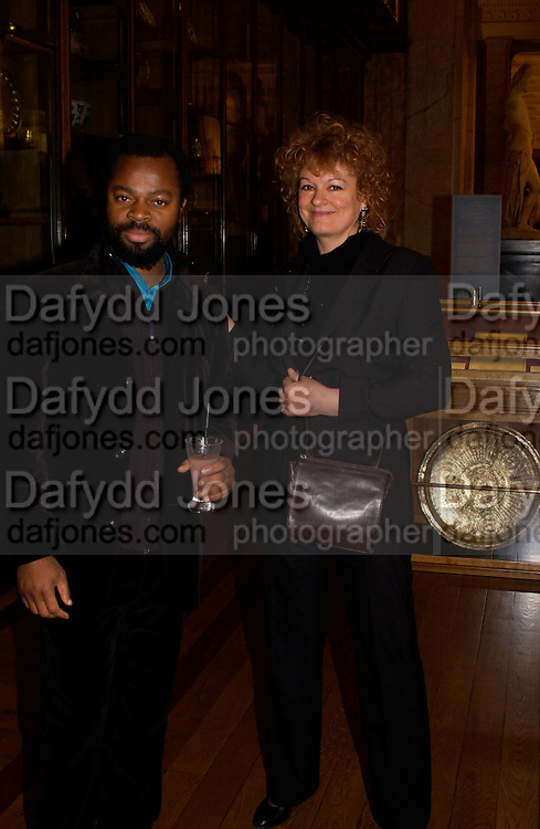 Ben Okri and Rosemary Cloones, British Museum 250th Anniversary party, 15 December 2003. © Copyright Photograph by Dafydd Jones 66 Stockwell Park Rd. London SW9 0DA Tel 020 7733 0108 www.dafjones.com