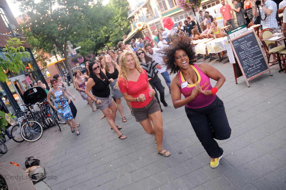 A Zumba Flash Mob ends a day of community awareness events at Yelp Helps at Les Deux Gamins on Prince Arthur. (Published in Midnight Poutine) 2012.