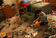 Cody and his stepbrother Andrew Pulliam, 14,  assemble an Air Force base out of legos in Cody's bedroom at their Westchase home.  Underwood who was diagnosed Aspergers syndrome at age 10, also has a touch of obsessive compulsive disorder.