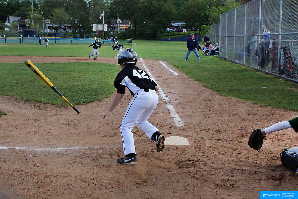 The Number 42 lives on….A young player wearing number 42 hits a pitch during the Norwalk Little League baseball competition at Broad River Fields,  Norwalk, Connecticut. USA. Photo Tim Clayton