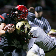 November 06, 2015; Oregon City, OR, USA; CONNOR MITCHELL (5)  is tackled close to the endzone.  Oregon City hosted Southridge at Pioneer Stadium.  Photo by David Blair