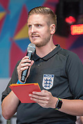 One of the first openly gay football referees speaks in Trafalgar Square - The London Pride parade and event in Trafalgar Square.