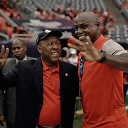 Houston mayor, Sylvester Turner smiles at former US olympian and University of Houston graduate, Carl Lewis, while both pose for a photo prior to the game.<br /> <br /> Todd Spoth for The New York Times.