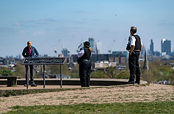 © Licensed to London News Pictures. 14/04/2020. London, UK. Police officers talk to a man on Primrose Hill in North London, during a pandemic outbreak of the Coronavirus COVID-19 disease. The public have been told they can only leave their homes when absolutely essential, in an attempt to fight the spread of coronavirus COVID-19 disease. Photo credit: Ben Cawthra/LNP