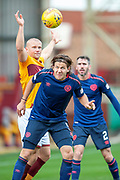 Peter Haring (#5) of Heart of Midlothian heads the ball clear during the Ladbrokes Scottish Premiership match between Motherwell and Heart of Midlothian at Fir Park, Motherwell, Scotland on 15 September 2018.