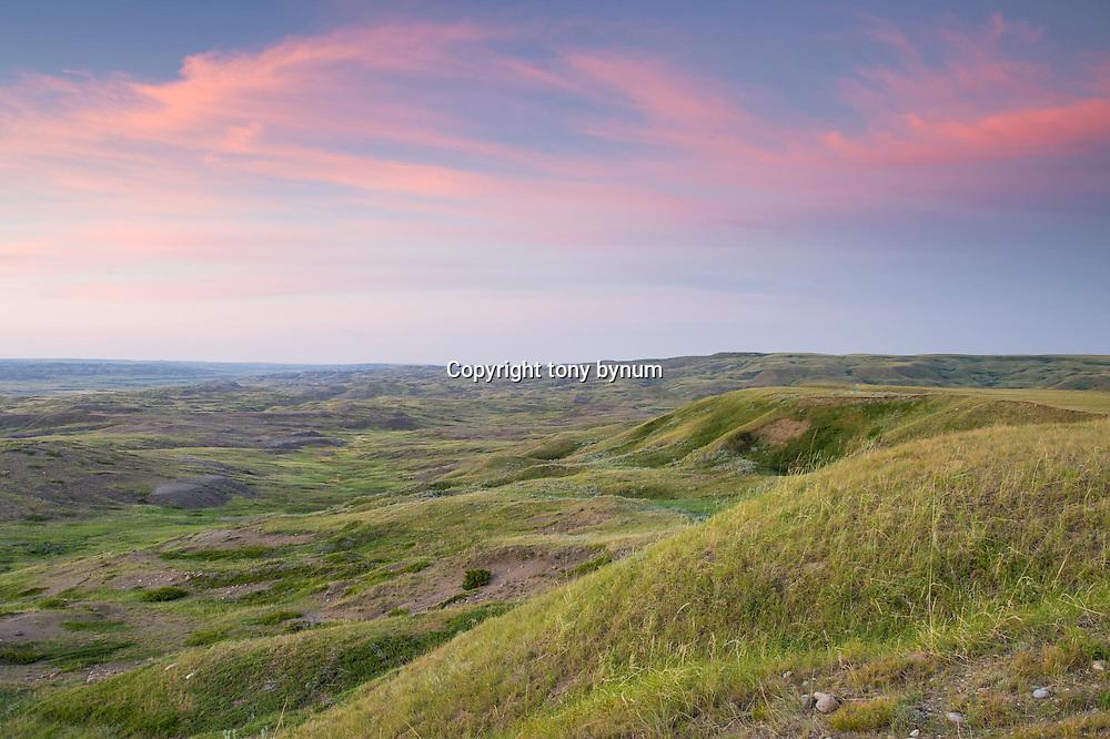 colorful sky as sun sets on montana prairie