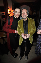 OLIVIA WILLIAMS and HARRY SHEARER at the gala night party of Losing It staring Ruby Wax held at he Menier Chocolate Factory, 51-53 Southwark Street, London SE1 on 23rd February 2011.