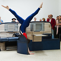 VENICE, ITALY - JUNE 01:  A female gymnast balances on a Delta Air Lines seat installation byJennifer Allora and Guillermo Calzadilla at the US Pavillion of the Giardini Biennale on June 1, 2011 in Venice, Italy. This year's Biennale is the 54th edition and will run from June 4th until 27 Novembe