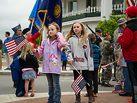 Youngsters watch the wreath ceremony honoring those lost at sea at Riverside Park during Laconia's Memorial Day parade on Monday morning.  (Karen Bobotas/for the Laconia Daily Sun)
