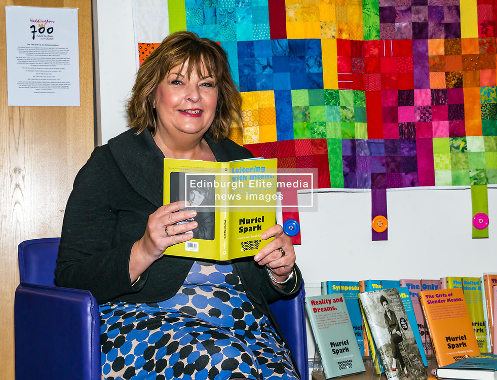 Pictured: Scottish Government Public Libraries Funding Announcement. Culture Minister Fiona Hyslop announces this year's successful bids to the £450,000 Public Library Improvement Fund (PLIF) at the John Grey Centre, Haddington Library, Haddington, East Lothian, Scotland, United Kingdom.  PLIF has been supporting innovative library projects since 2006 which help both individuals and communities.  Fiona Hyslop with Muriel Spark books donated by Edinburgh's Lord Provost, Frank Ross. 13 December 2018  <br /> <br /> Sally Anderson | EdinburghElitemedia.co.uk
