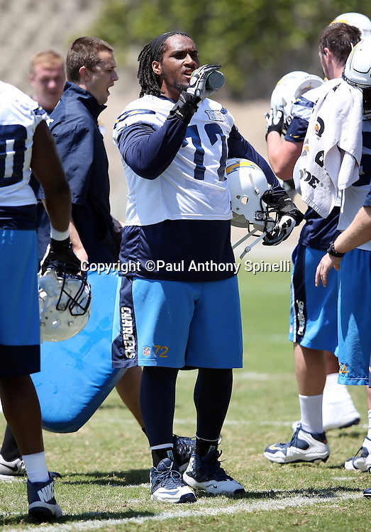 San Diego Chargers offensive tackle Joe Barksdale (72) takes a drink during the San Diego Chargers Spring 2015 NFL minicamp practice held on Tuesday, June 16, 2015 in San Diego. (©Paul Anthony Spinelli)