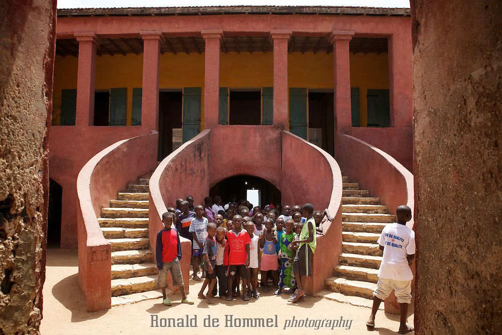 A group of Senegales scholl children visits the Maison des Esclaves (the slave house) on Ile de Goree off the coast of Dakar in Senegal. It is an important symbol against the slave trade. Even though some historians claim Goree was not actually a major post in the slave trade the small colonial island with its slave museum attracts many visitors from all over the world. Many are African Americans who came to Africa to explore their roots.