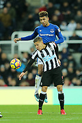 Dwight Gayle (#9) of Newcastle United wins the header during the Premier League match between Newcastle United and Everton at St. James's Park, Newcastle, England on 13 December 2017. Photo by Craig Doyle.