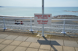 Painting the railings, Aberystwyth promenade, Wales May 2016