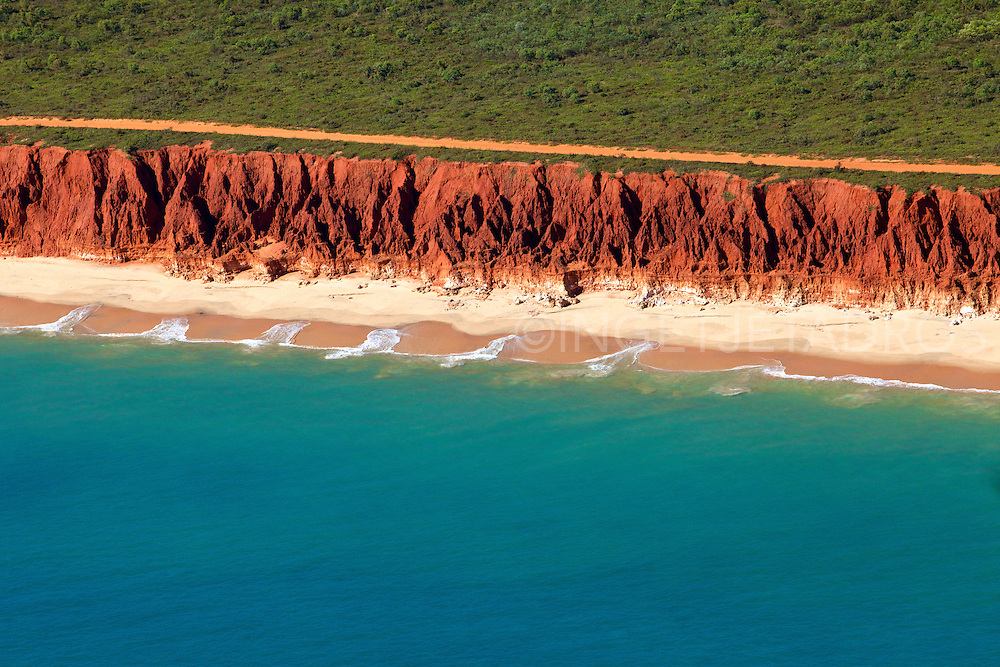 Red Cliffs, Pristine Sea and  Idyllic Coastal Bush at James Price Point, which is now under threat by a proposed gas hub by Woodside Petroleum.<br /> JJP  is located 52.95kms North of Broome, 78.89kms SouthWest of Beagle Bay and 160.21kms West of Derby, in the state of Western Australia.<br /> Now threathened by a 30 billion gas hub, The Browse Basin gas fields off the coast of Broome can be exploited to the economic benefit of the country and its citizens without destroying one of the most pristine places on this planet, by piping down to existing facilities in the Pilbara or processing it off shore.