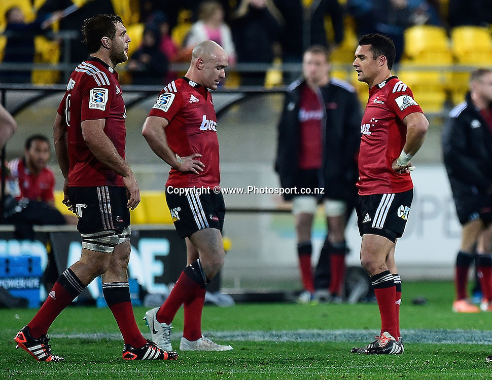 Luke Whitelock (L), Willi Heinz and Dan Carter (R of the Crusaders stand dejected after their loss during the Super Rugby - Hurricanes v  Crusaders rugby match at the Westpac Stadium in Wellington, New Zealand on the 28th of June 2014. Photo: Marty Melville/www.Photosport.co.nz