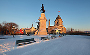 Samuel de Champlain monument, by Paul Chevre, erected 1898, in honour of the founder of Quebec City, on the Dufferin Terrace, and the Louis S St-Laurent Building, built 1872-73 in Second Empire style, the Old Post Office, in Quebec City, Quebec, Canada. Samuel de Champlain, 1574-1635, was a navigator who founded New France and Quebec City and mapped the Canadian coast. The Historic District of Old Quebec is listed as a UNESCO World Heritage Site. Picture by Manuel Cohen