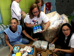 June 30, 2017 -  Caracas, Venezuela - Employees of the children's hospital JM de los Rios review a water donation for patients. Venezuela is experiencing a profound humanitarian crisis. Severe shortages of medicines and medical supplies make it extremely difficult for many Venezuelans to obtain essential medical care. (Credit Image: © El Universal via ZUMA Wire)