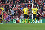 AFC Bournemouth's striker Glenn Murray takes penalty and Watford FC goalkeeper Heurelho Gomes dives the right way during the Barclays Premier League match between Bournemouth and Watford at the Goldsands Stadium, Bournemouth, England on 3 October 2015. Photo by Mark Davies.
