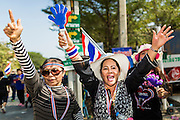 22 DECEMBER 2013 - BANGKOK, THAILAND:  Anti-government protestors dance on sing in the street near the home of caretaker Prime Minister Yingluck Shinawatra. Hundreds of thousands of Thais gathered in Bangkok Sunday in a series of protests against the caretaker government of Yingluck Shinawatra. The protests are a continuation of protests that started in early November and have caused the dissolution of the Pheu Thai led government of Yingluck Shinawatra. Protestors congregated at home of Yingluck and launched a series of motorcades that effectively gridlocked the city. Yingluck was not home when protestors picketed her home.    PHOTO BY JACK KURTZ