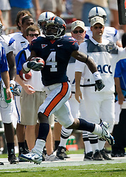 Virginia cornerback Vic Hall (4) returns a Duke punt for 67 yards.  The Virginia Cavaliers defeated the Duke Blue Devils 23-14 at Scott Stadium in Charlottesville, VA on September 8, 2007  With the loss, Duke extended their longest-in-the-nation losing streak to 22 games.
