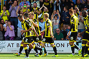 Burton Albion celebrate their opening goal of the season during the Sky Bet League 1 match between Burton Albion and Scunthorpe United at the Pirelli Stadium, Burton upon Trent, England on 8 August 2015. Photo by Aaron Lupton.